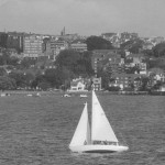 Greg Hyde  sailing in Sydney Harbour. Greg is 5 from the left/4 from the right in a life jacket.