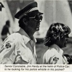 Senior Constable, (Jim) James Hardy at the Helm of Police Car